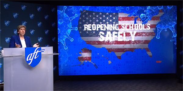 "Randi Weingarten at the AFT national convention. Graphic behind her reads ""Reopening Schools Safely."""
