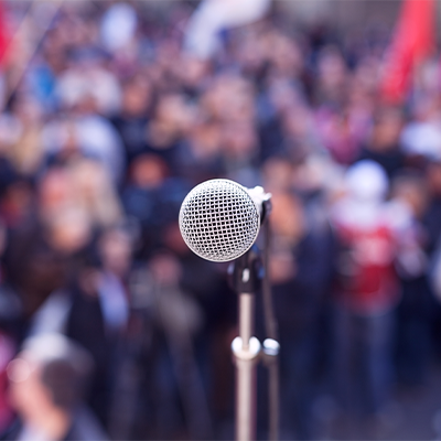 Microphone in front of a crowd.