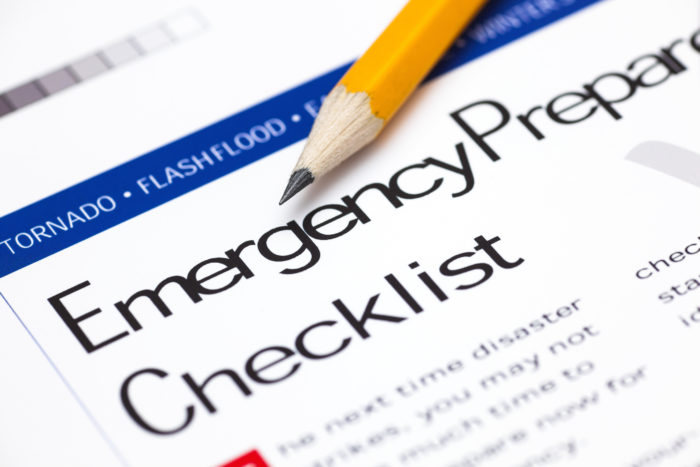 "Pencil on top of paper with title ""Emergency Preparedness Checklist."""