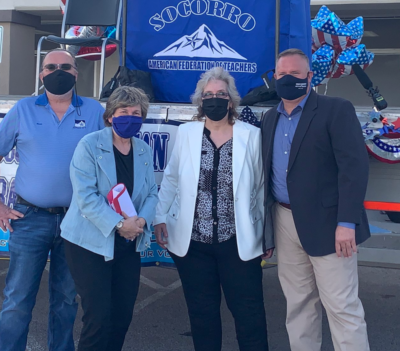 El Paso A-F-T President Ross Moore, A-F-T President Randi Weingarten, Socorro A-F-T President Veronica Hernandez, and Texas A-F-T President Zeph Capo stand outside at an event. All are wearing face masks.